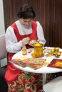 Russian woman painting a matryoshka at bit international tourism exchange in milan italy february paints reference point for the Royalty Free Stock Images