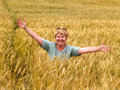 The Russian woman in a wheaten field Royalty Free Stock Photo