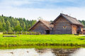 Russian wooden architecture old rural houses example on the lake coast Royalty Free Stock Images