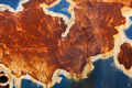 Rust dark orange texture and blue pinture Royalty Free Stock Photo