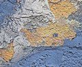 Rust on the iron. The textures and background of cracked blue and yellow paint on the metal Royalty Free Stock Photo