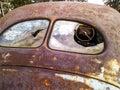 Rust old car broken window rusting in an open field Stock Photos