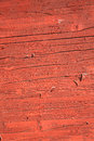 Rust red brown peeling paint wood background old planks with a wash Royalty Free Stock Image