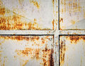 Rust starting on tin metal gate Royalty Free Stock Photo