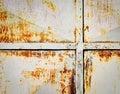 Rust starting on tin metal gate Royalty Free Stock Photo