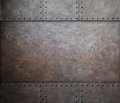 Rust steel metal texture with rivets as steam punk background Royalty Free Stock Photos