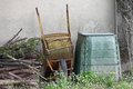 Rusted cangrejo and container for the composter and organic wast waste in a garden Stock Photo