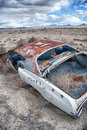 A rusted car in the desert Royalty Free Stock Photo