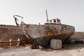 Rusted fishing boat abandoned on boats graveyard in jaffa Stock Images