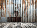 Rusted galvanized iron plate with wood floor Royalty Free Stock Photo