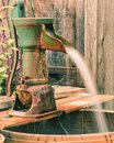 A rusted green well water hand pump Royalty Free Stock Photo