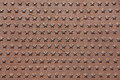 Rusted iron cast panel covered with five-pointed stars pattern. Royalty Free Stock Photo