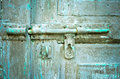 Rusted keyhole on green wooden door Stock Photography