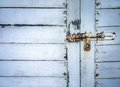 Rusted keyhole on white wooden door close up of Royalty Free Stock Images