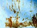 Rusted Metal Scratches in Blue Paint Stock Image