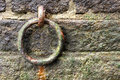 Rusted old ring in a harbor on a rainy day Stock Photography