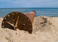 Rusted pipe in sea Stock Images