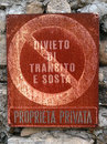 Rusted plate private property prohibition of transit and parking for with signal indicating in italian language Royalty Free Stock Image