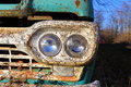 Rusted truck headlights front on view of old with Stock Photo