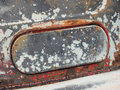 Rusted and weathered air intake flap of a rotten old truck Royalty Free Stock Photo