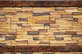 Rusted Wood and Stone Masonry Wall