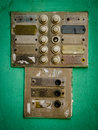 Rustic apartment intercom buzzer old agaist green painted wall Stock Photo