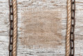 Rustic background with burlap rope and chain on the old wood Stock Photos