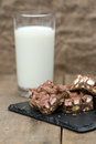 Rustic background with rocky road dessert squares with glass of on milk Stock Image