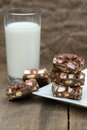 Rustic background with rocky road dessert squares with glass of on milk Royalty Free Stock Image