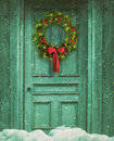 Rustic barn door with Christmas wreath Royalty Free Stock Photo