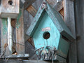 Rustic birdhouse a turquoise bird house creates an artistic image in the garden Stock Photo