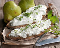 Rustic bread with curd and white cheese on wooden ground Stock Photography