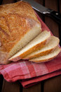 Rustic bread cut into slices Royalty Free Stock Image