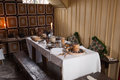 Rustic breakfast interior of an old country house with table set for a Stock Image