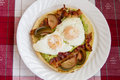 Rustic breakfast tasty guacamole bacon and fried eggs Royalty Free Stock Photography