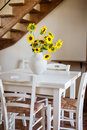 Rustic a bunch of vibrant potted sunflowers into a warm and cozy living room Royalty Free Stock Images