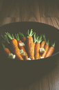 Rustic carrotts in a pan image of carrots with butter and herbs Stock Photo