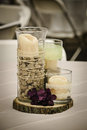 Rustic centerpiece a wedding with rocks candles lace wood and twine Stock Photos