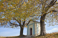 Rustic christian chapel in autumn Stock Photos