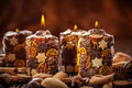 Rustic Christmas candles with spices and  nuts Stock Images