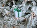 Rustic Christmas decoration hanging over white tree Royalty Free Stock Photo