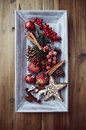 Rustic christmas decorations on a wooden tray top view Stock Images
