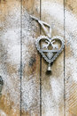 Rustic christmas heart on wooden table and sugar Royalty Free Stock Photos