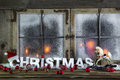 Rustic christmas window with red candles, horse and greeting tex Royalty Free Stock Photo