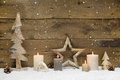 Rustic country background - wood - with candles and snowflakes f Royalty Free Stock Photo