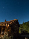 Rustic country house at night under the stars