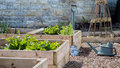 Rustic Country Vegetable & Flower Garden with Raised Beds. Spade & Watering Can Royalty Free Stock Photo