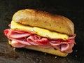 Rustic deli cold cuts sandwich Royalty Free Stock Photo
