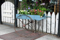 Rustic flower cart a in front of a weathered white fence Royalty Free Stock Photos