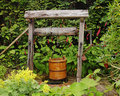 Rustic Garden Well with water Bucket Royalty Free Stock Image